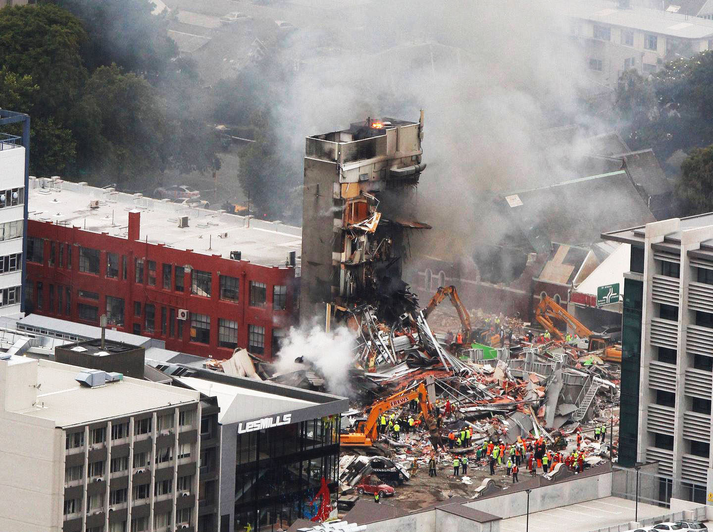 Firefighters, police and other search and rescue crews at work on the collapsed CTV building in...