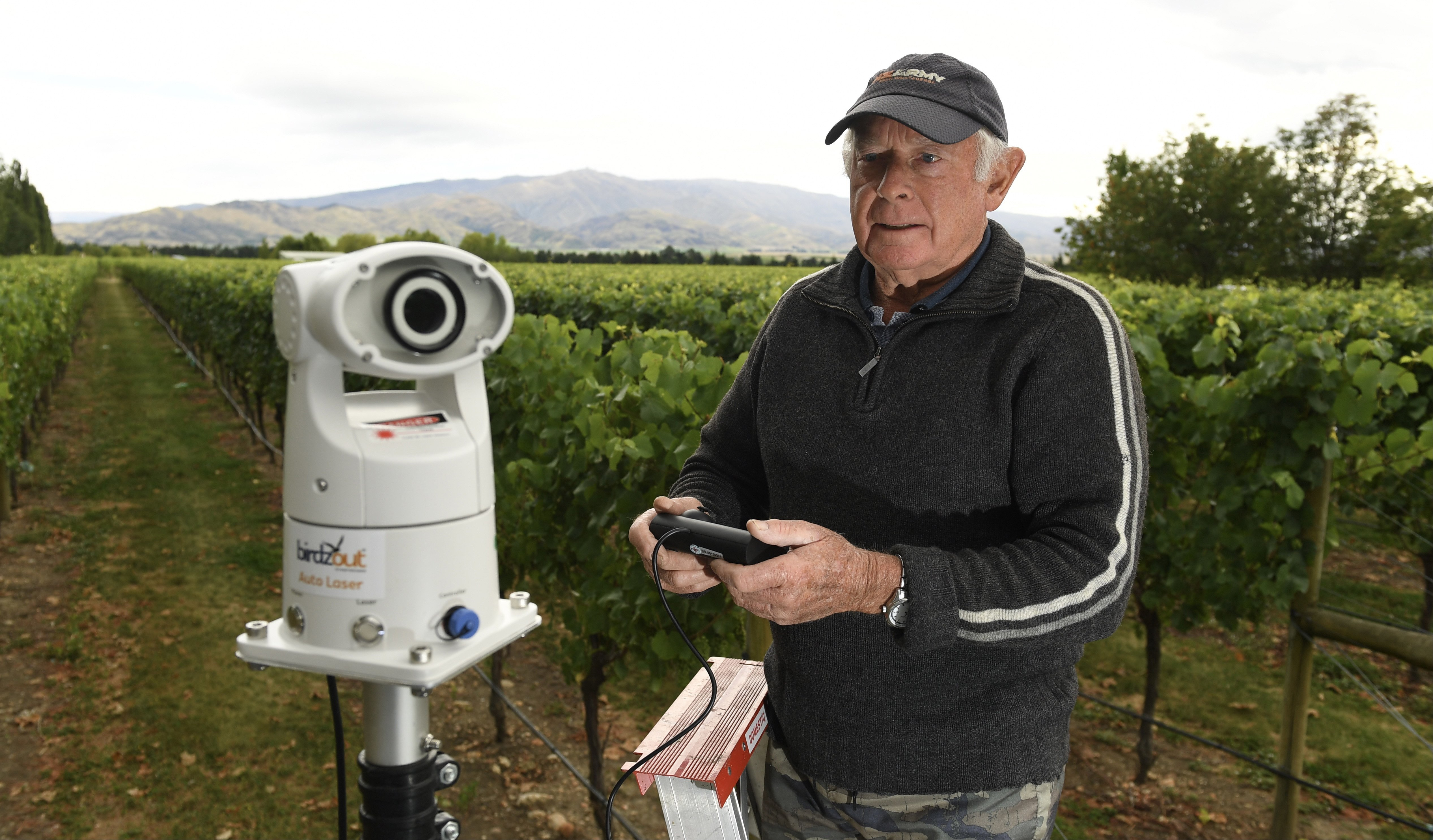 Viticulturist Barry Hunt with ''Birdzout'' auto bird scare laser to be used at Ewing Stevens'...