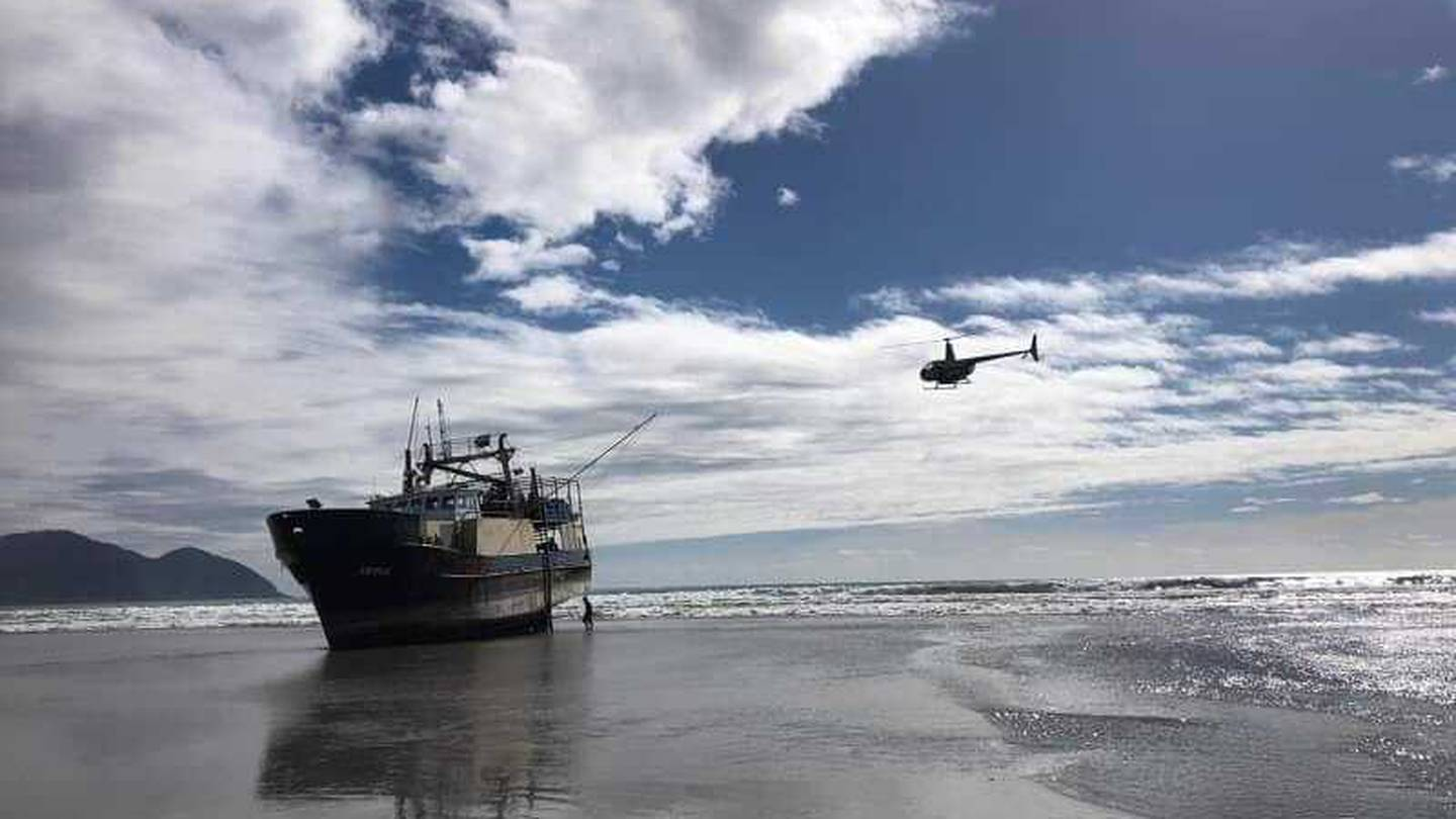 The boat which has beached on Big Bay. Photo: Supplied via NZH
