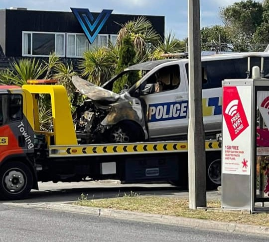 One of the damaged vehicles being towed away from New Brighton police station. Photos: Supplied