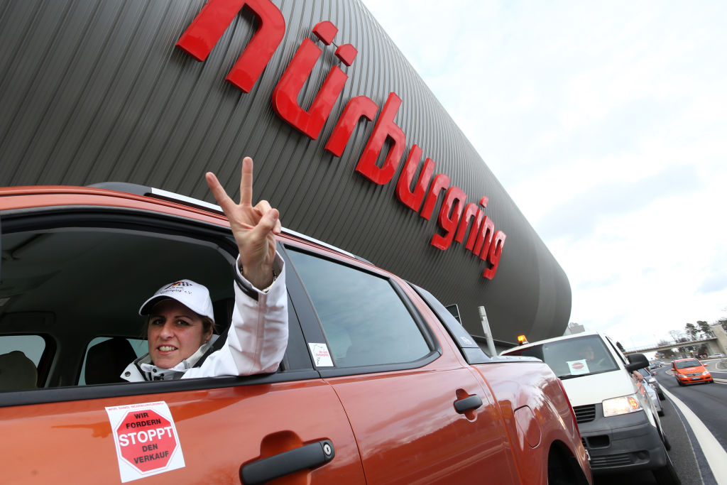 Sabine Schmitz in her car during a car parade at the Nuerburgring race track in Germany. Photo:...