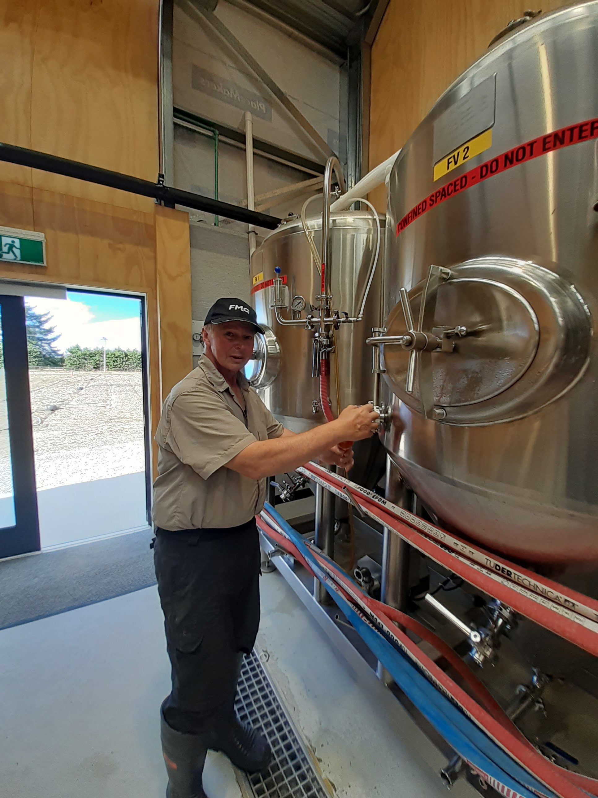 Grenville Caughey checks the product at the Otago Polytechnic Brew School's commercial brewery.