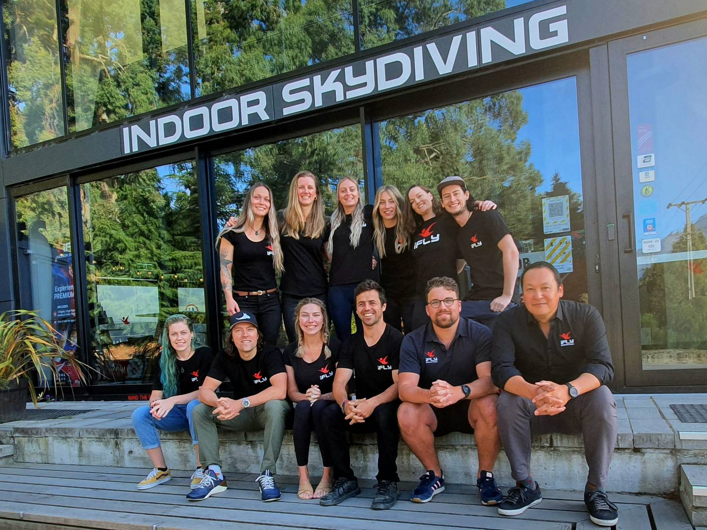 Matt Wong, right, with the Brecon Street iFly team in Queenstown. Photo: Supplied