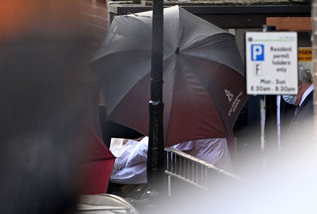 Prince Philip was shielded from the media with umbrellas as he left King Edward VII Hospital for...