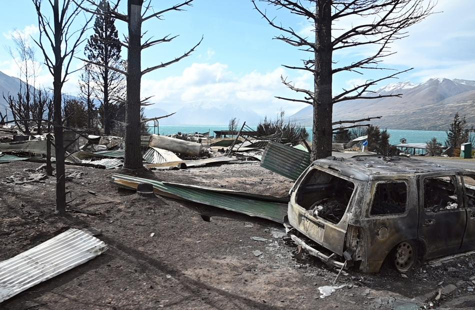 Cars were reduced to burnt-out husks by the fire as it spread through Ohau Village. PHOTO: CRAIG...