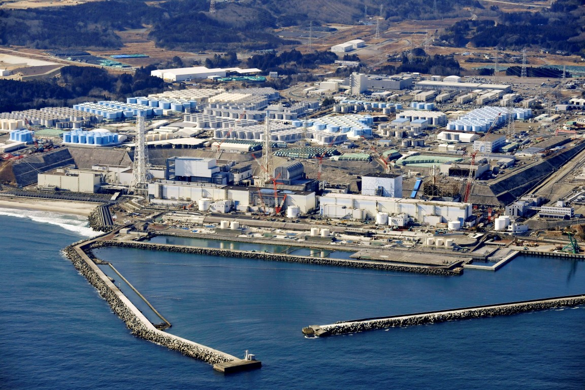 An aerial photograph taken in February shows the storage tanks for treated water at the tsunami...