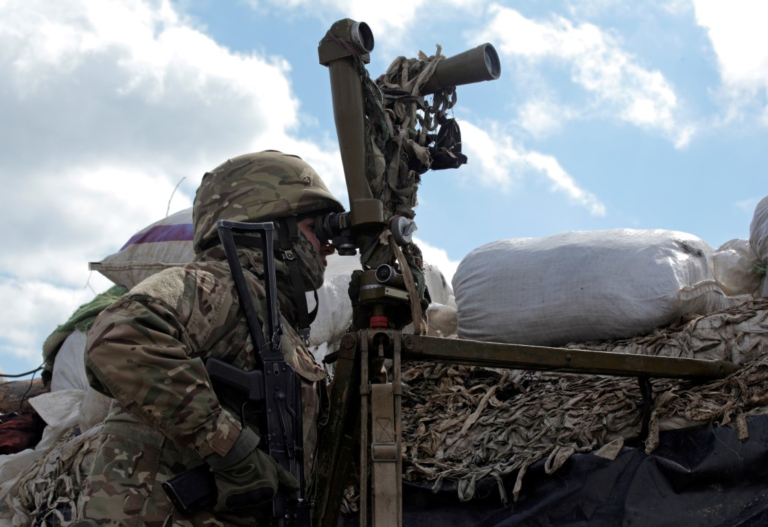 A Ukrainian armed forces member at the line of separation near the rebel-controlled city of...