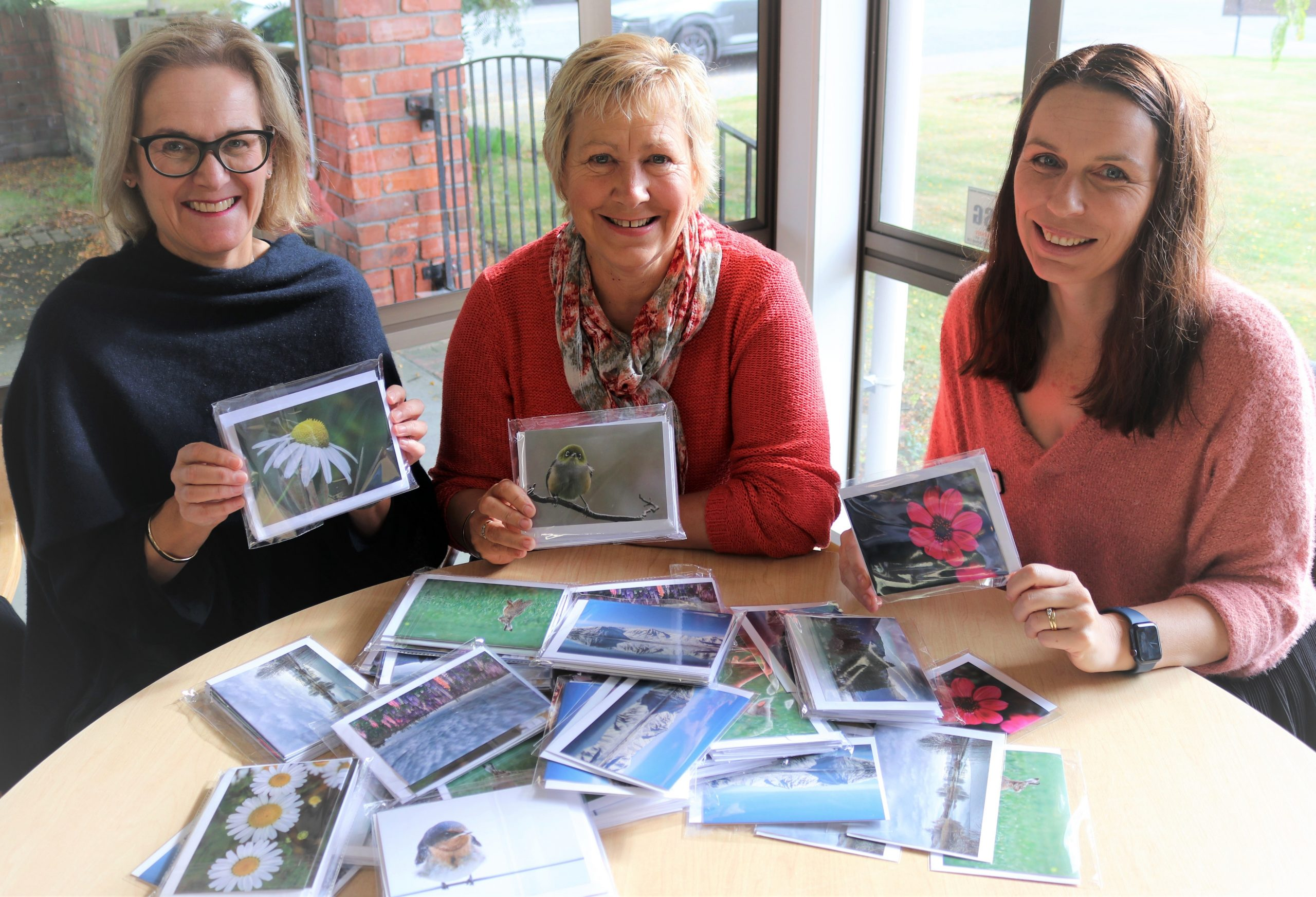 Checking out the new greeting cards are (from left) Cancer Society manager Annie Bonifant,...
