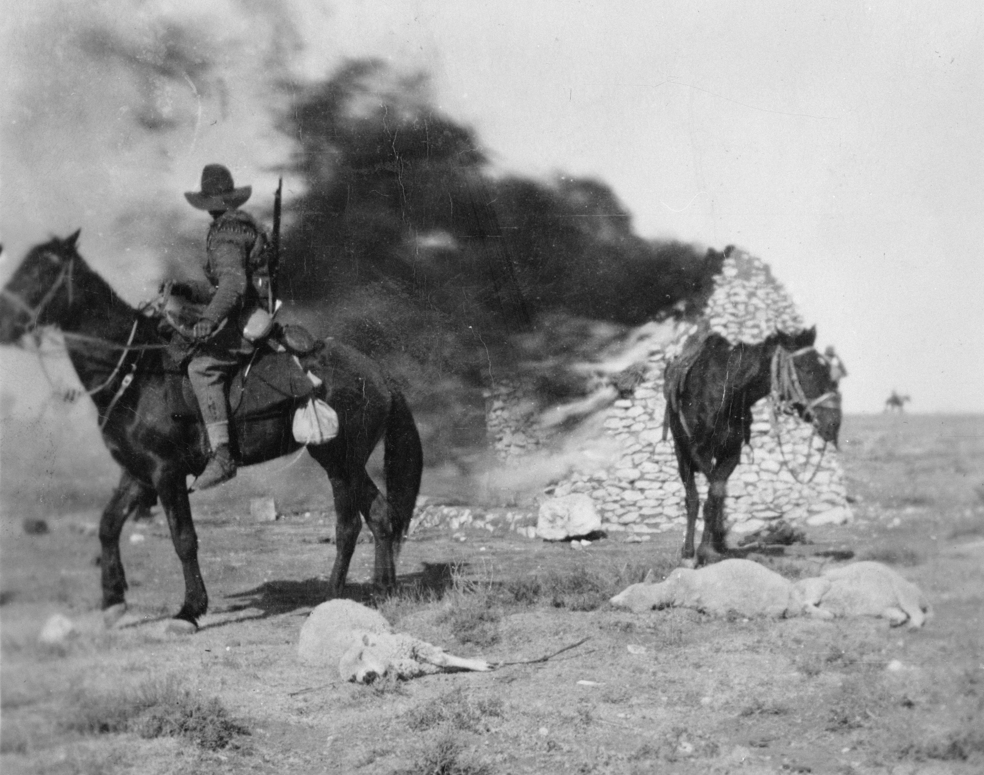 New Zealand Sixth Contingent men burn a Boer farmhouse after slaughtering the  livestock. Photo;...