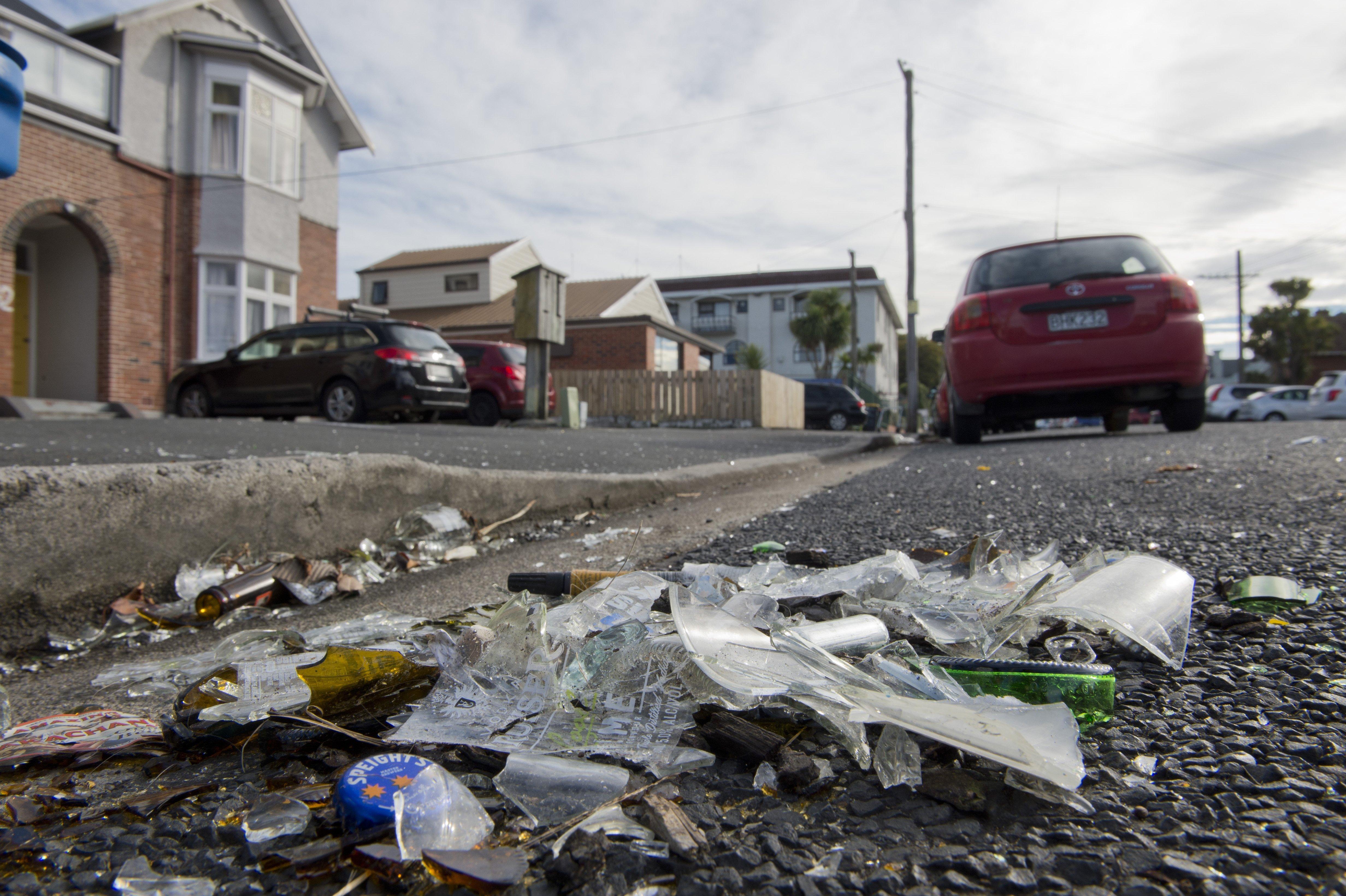 Broken glass litters Dunedin's Castle St this week. Photo: Gerard O'Brien.