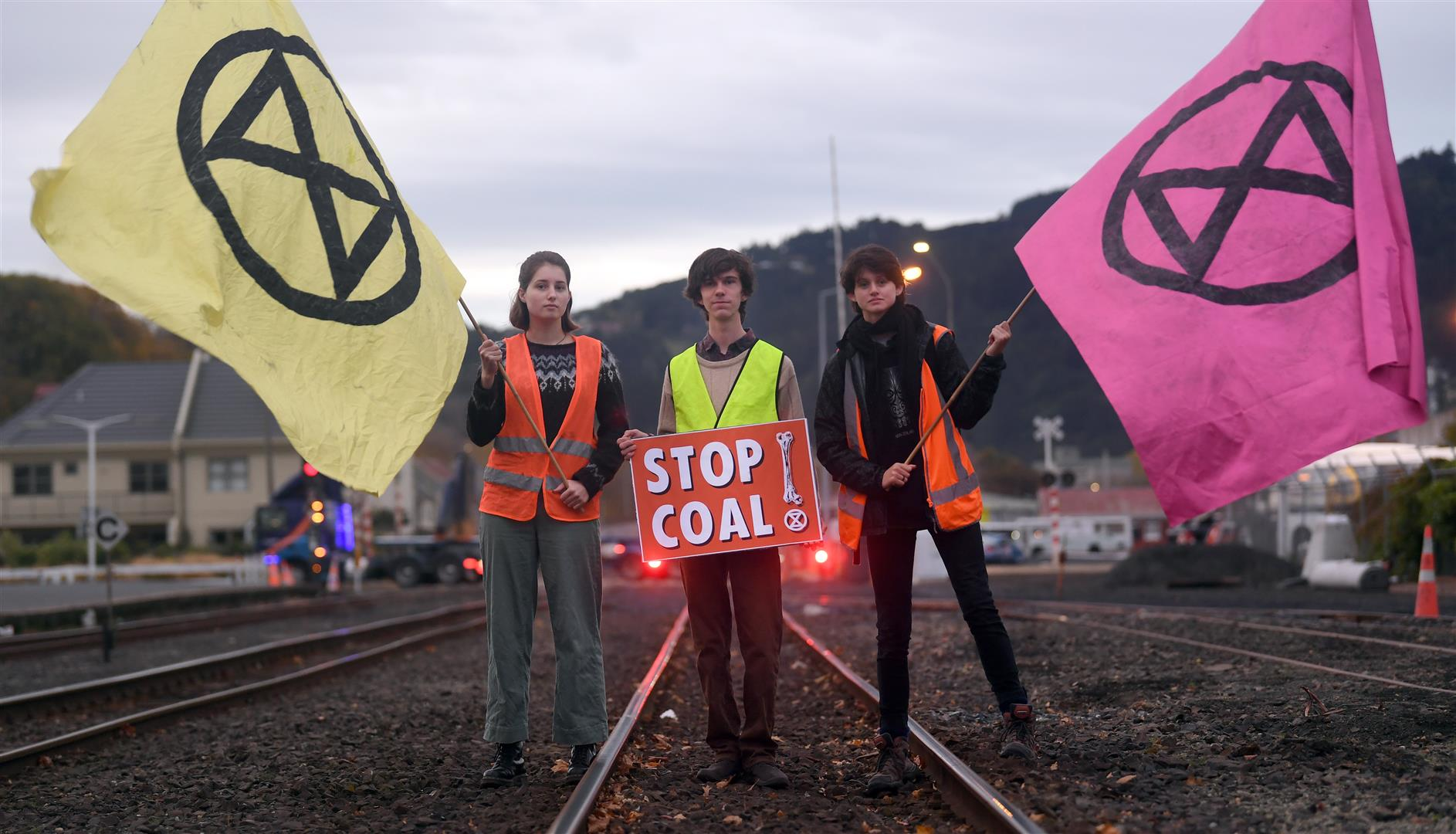 Protesters opposing the use and transport of coal block the railway tracks near the Dunedin Railway Station this morning. Photo: Stephen Jaquiery