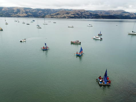 Akaroa school students cross the harbour in homemade rafts as part of the school's yearly Frank...