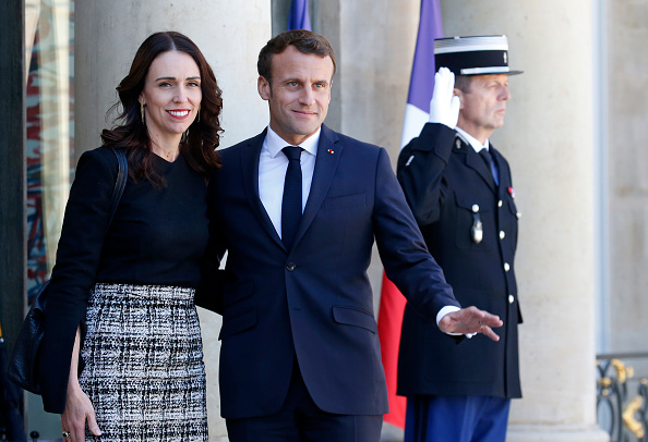 French President Emmanuel Macron welcomes Jacinda Ardern to Paris prior to their meeting over the...