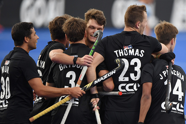 Dominic Newman is congratulated after scoring a goal during the FIH Pro League match between the...