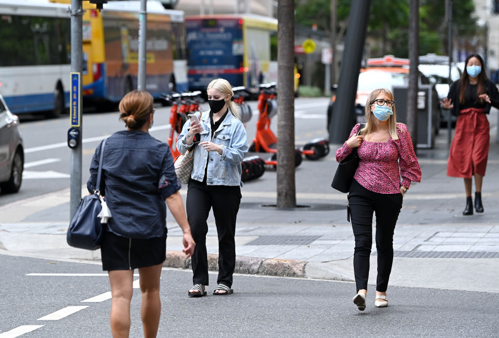 People walk through the Brisbane CBD during the three-day lockdown which ends today. Photo: Getty