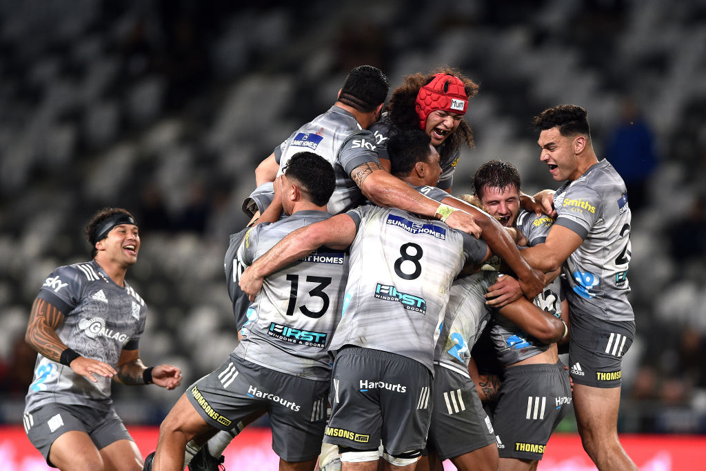 Chiefs players mob Damian McKenzie after his golden point penalty won the game. Photo: Getty Images