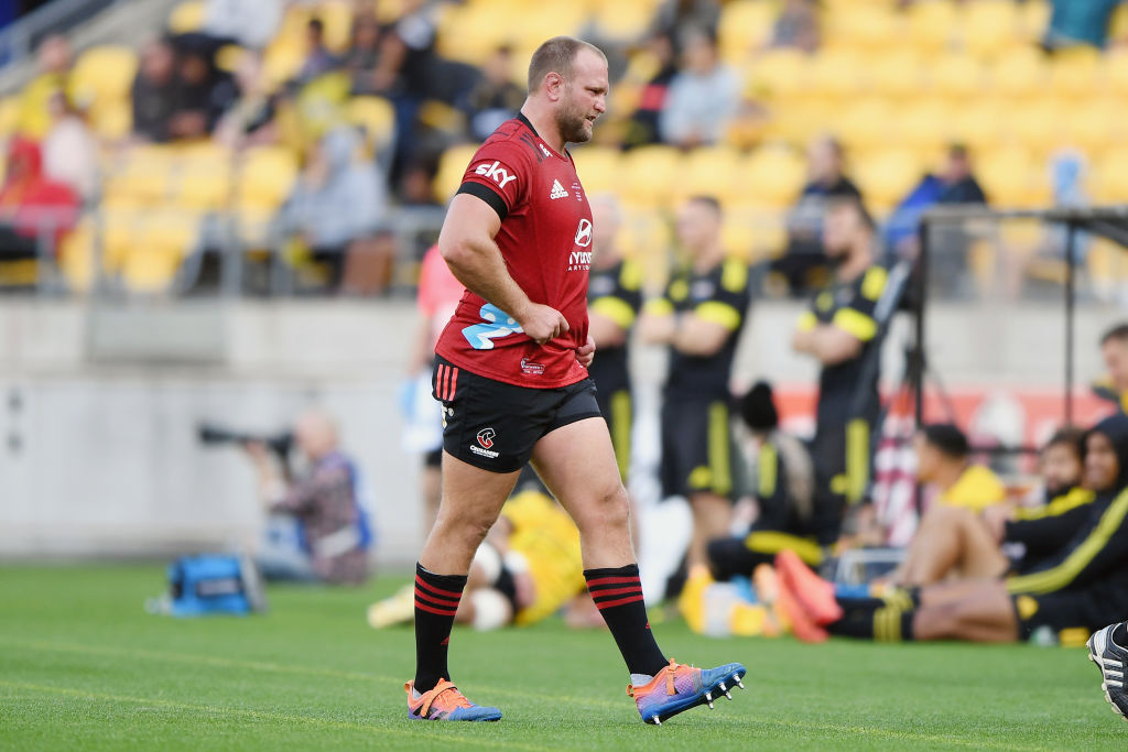 Joe Moody leaves the field with an injury during the match between the Crusaders and the...