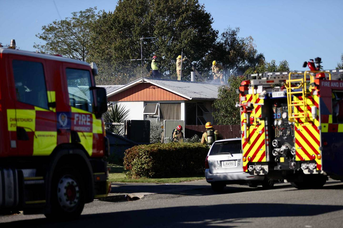 Fire crews battling the house fire in Kaiapoi. Photo: George Heard