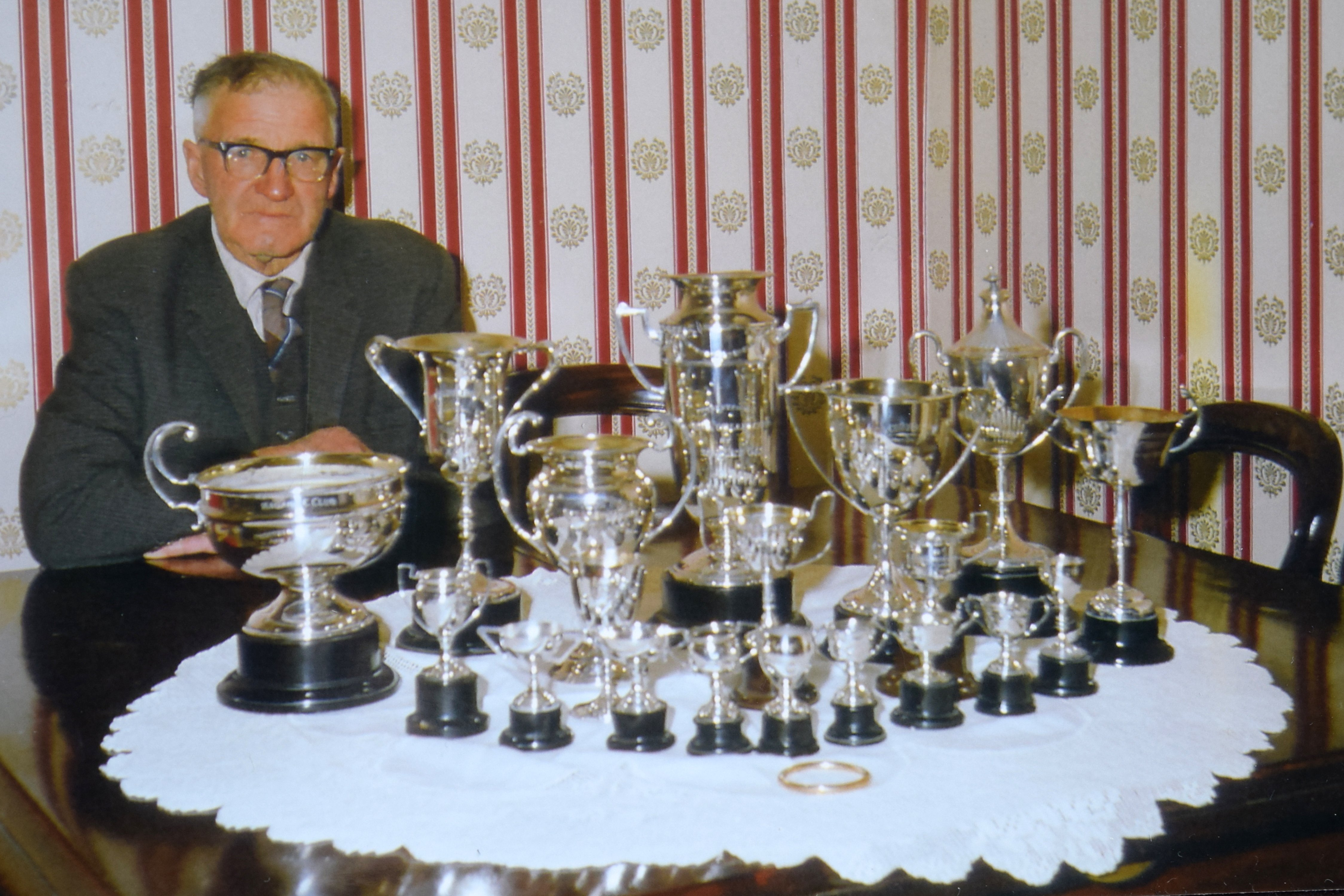 Kauana Sheep Dog Trial Club life member the late John Anderson displays his collection of...