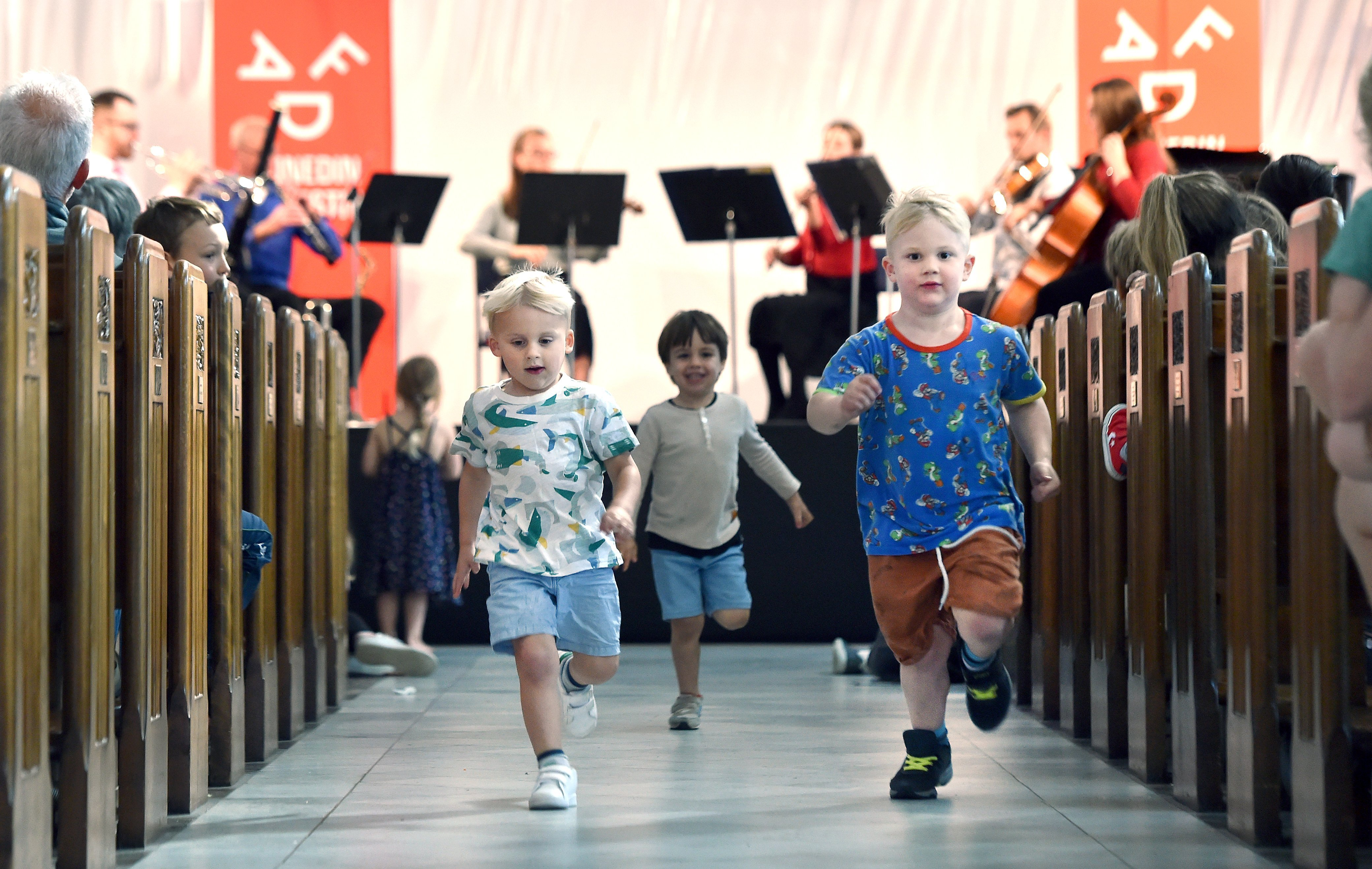 Big fans of Beethoven and running around churches (from left) Jimmy Burke (3), Oscar Muir (3) and Matteo Guidi (4) all of Dunedin, run down the central aisle at at St Paul's Cathedral. PHOTO: PETER MCINTOSH