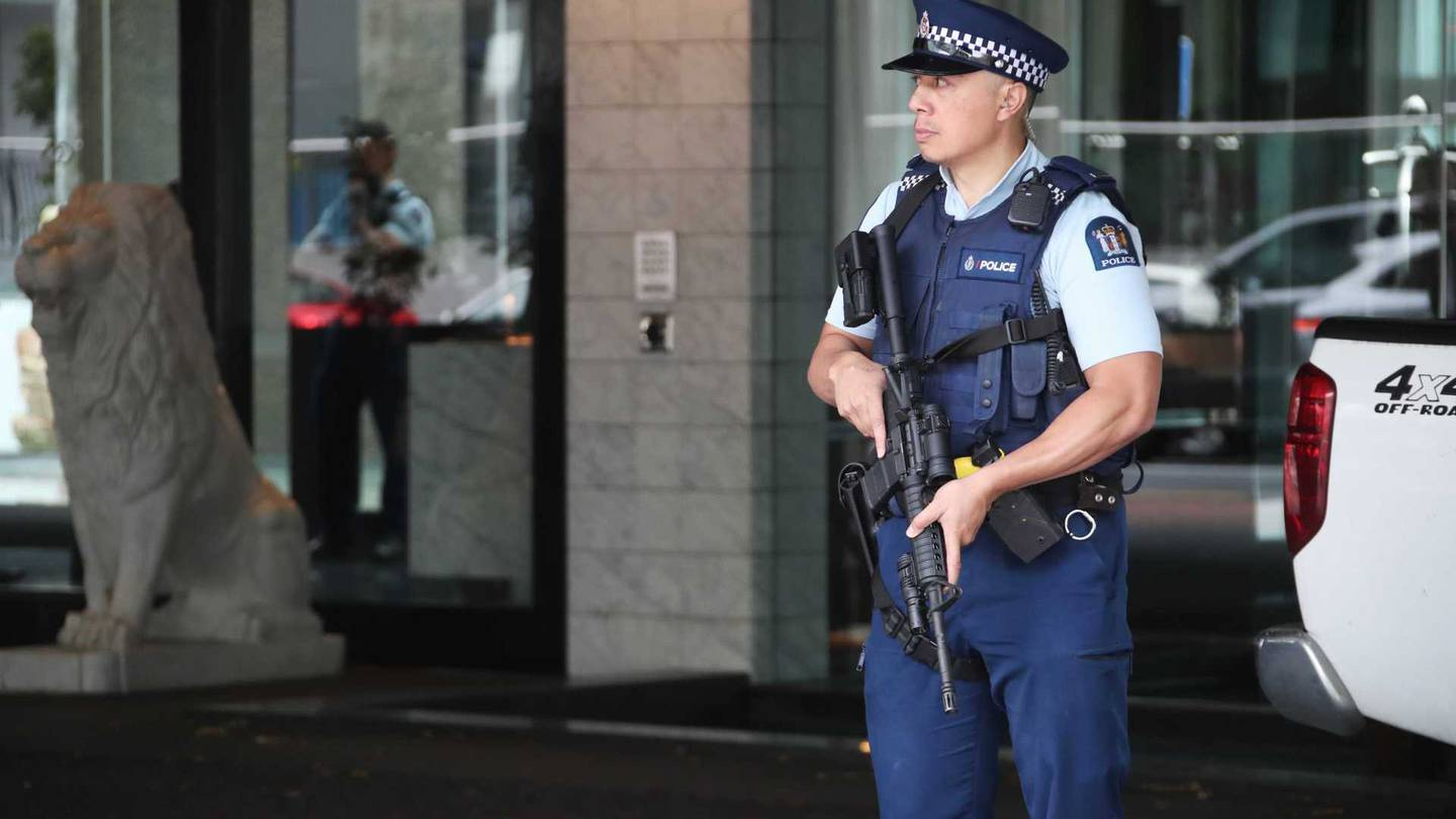 Armed police stand guard outside the Sofitel Hotel on Auckland's Viaduct this morning. Photo: NZ...