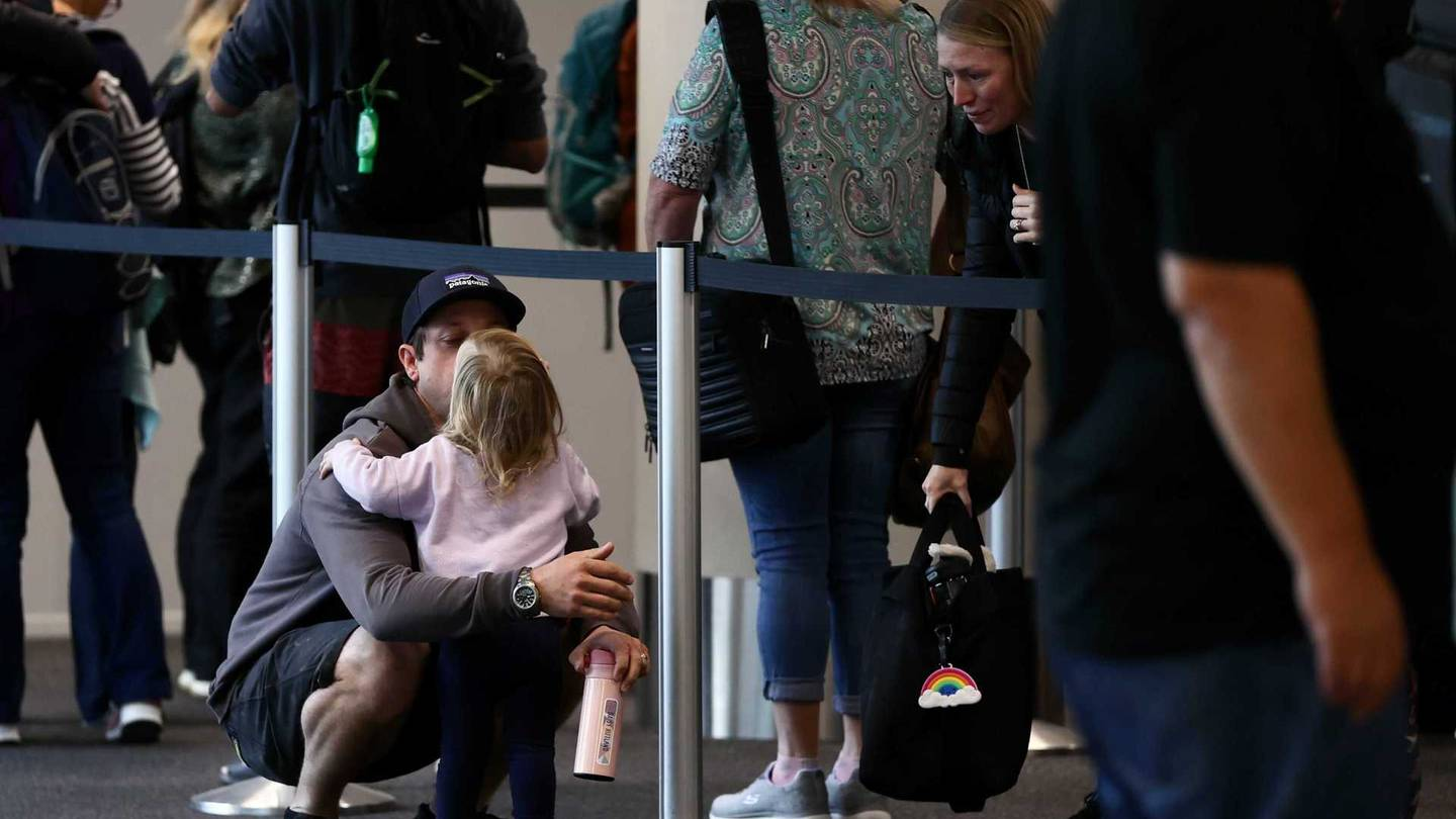 Travellers waiting to board flights to Australia from Christchurch. Photo: George Heard