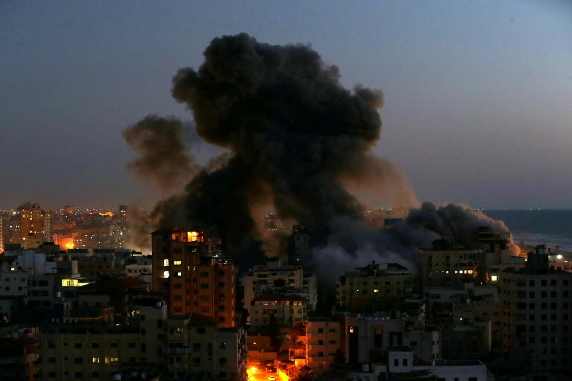 Smoke rises from a building in Gaza after it was destroyed by Israeli air strikes amid a flare-up...