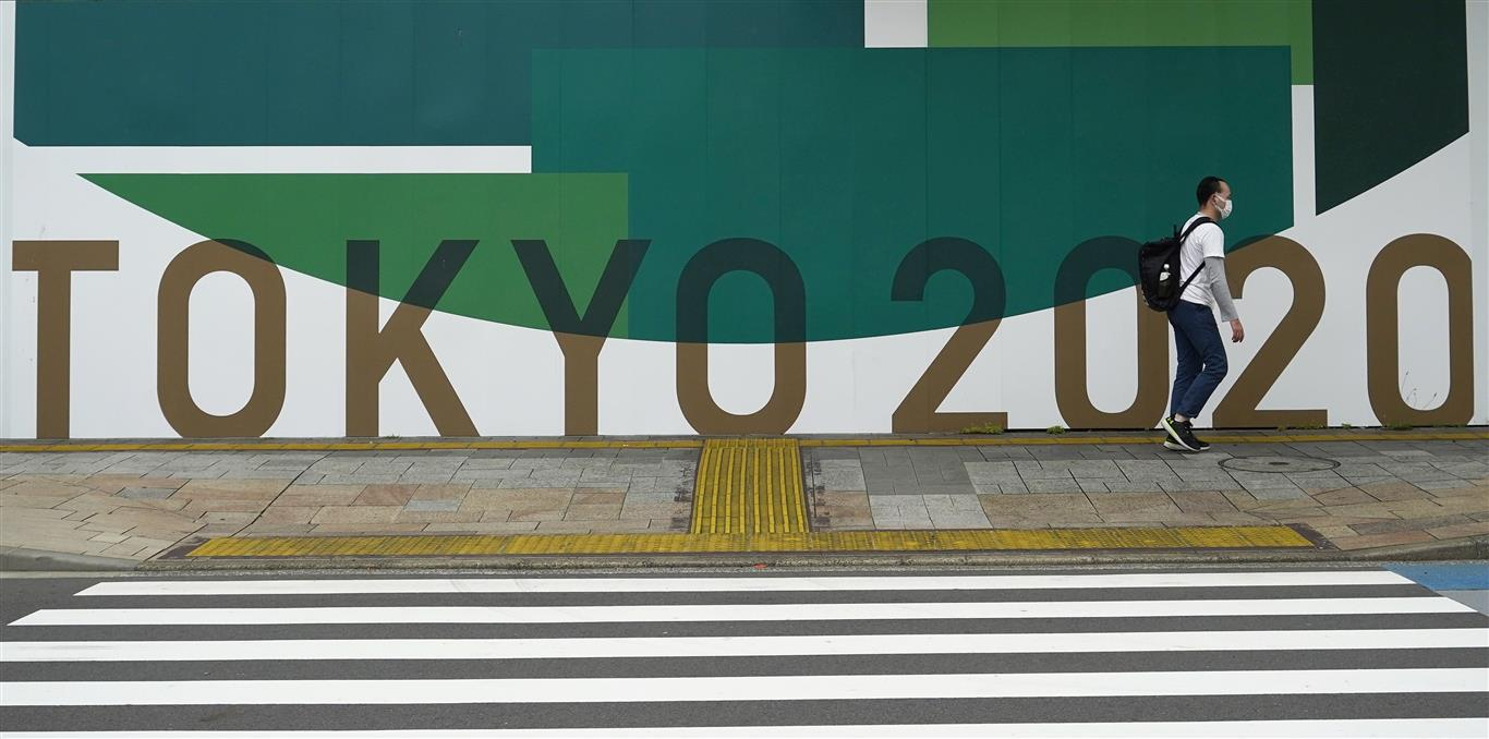 A sign advertising the 2020 Olympic Games, which have been postponed to 2021 due to coronavirus,...