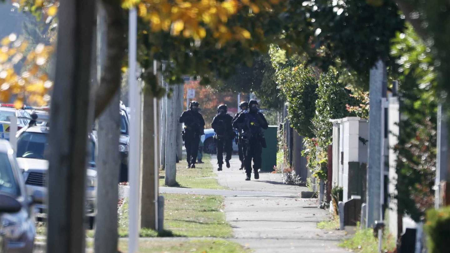 Armed police converged on a Christchurch street earlier today. Photo: George Heard