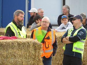 Chief scrutineer Malcolm Lovett (from left), starting volunteer Neville Gibb and clerk of the...