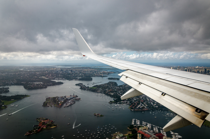 A plane flies over Sydney as it comes in to land. Photo: Getty