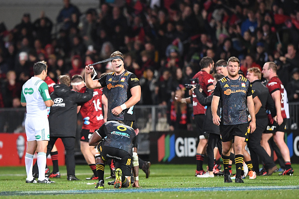 The dejected Chiefs at fulltime. Photo: Kai Schwoerer / Getty Images