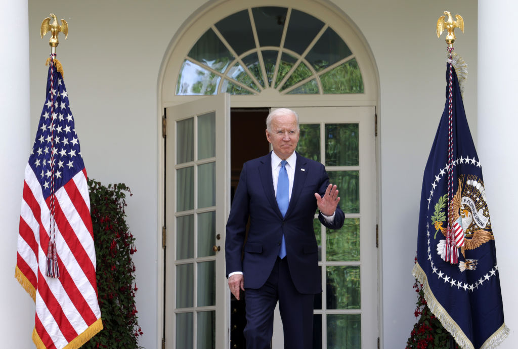 US President Joe Biden arrives without a mask in the Rose Garden at the White House to deliver...