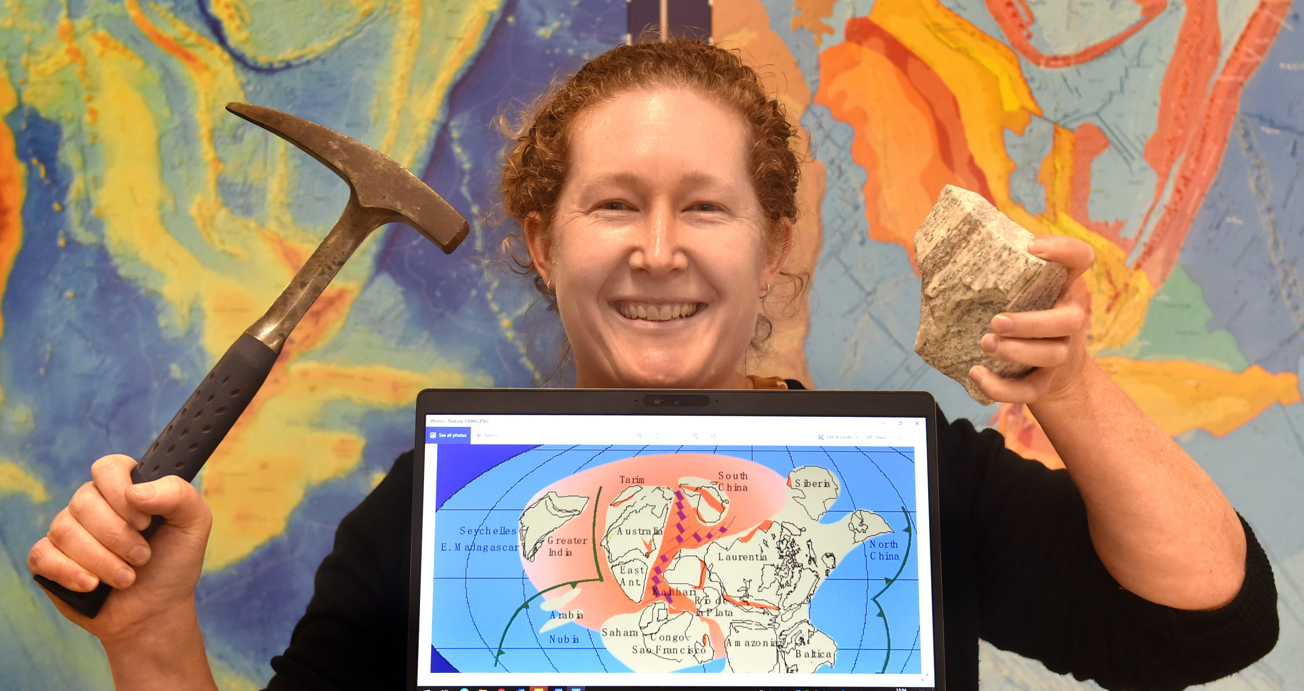 GNS Science geologist Dr Rose Turnbull with a lump of granite from Fiordland, and a graphic...