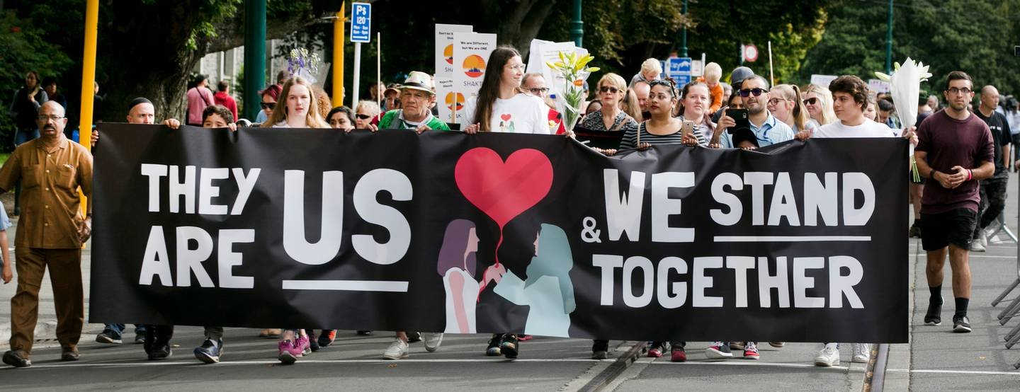 Marchers express support for the Muslim community after the Christchurch terror attacks. Photo:...