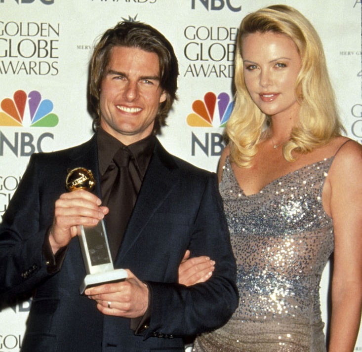 Tom Cruise in 2000 with his Golden Globe for best supporting actor in Magnolia and Charlize...