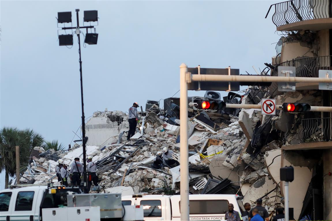 Emergency crews at the scene of the collapsed building in Surfside, near Miami Beach. Photo: Reuters