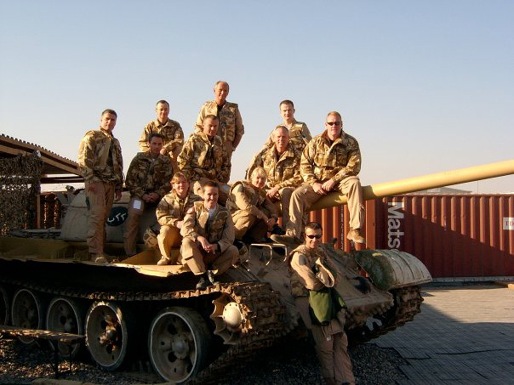 Shelley Charlton with her former RAF colleagues sitting on a non-functioning tank in Basra, Iraq.