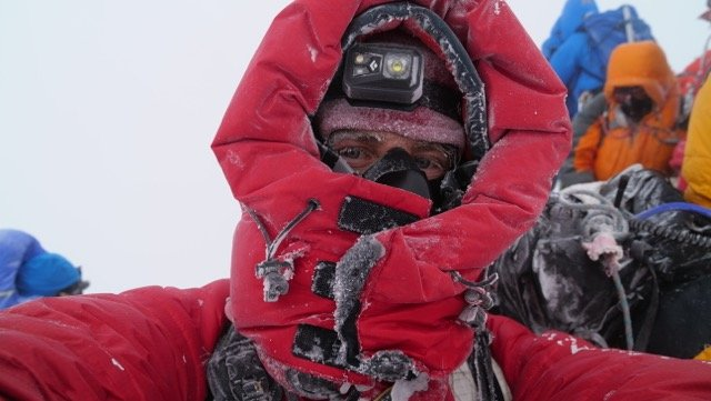 Wanaka documentary maker Scott Simper on the summit of Mt Everest in 2017. Mr Simper caught Covid...