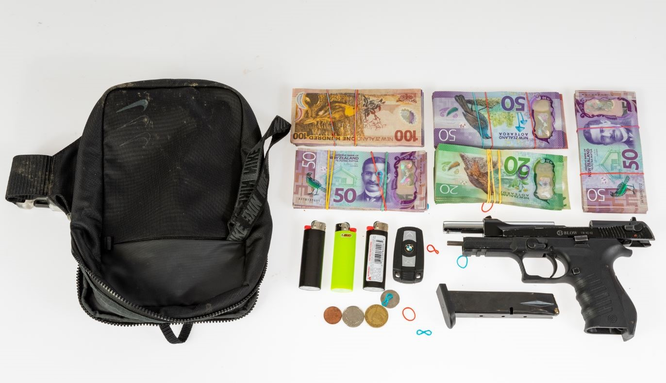 A firearm and about $42,000 in cash has been seized. Photo: supplied