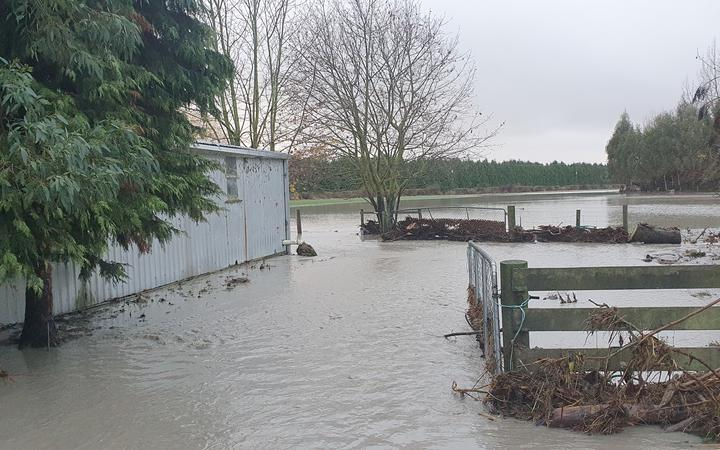 The exterior of the Williams family property remains submerged in floodwater. Photo: Supplied /...