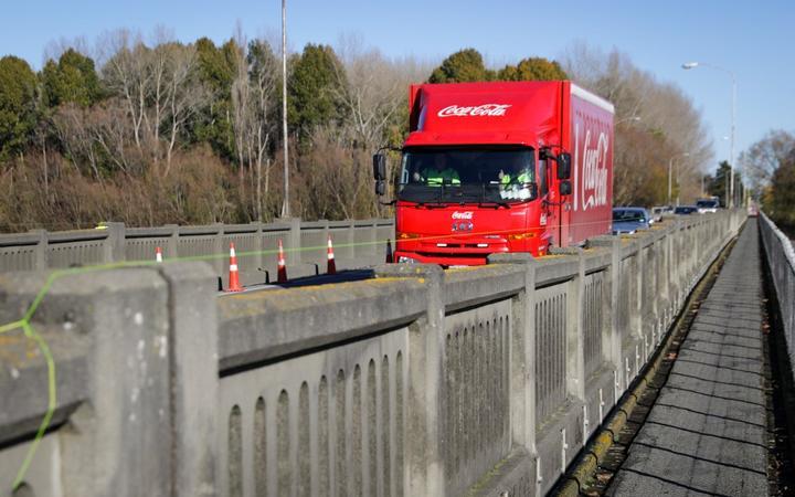 A truck passes over the reopened Ashburton River bridge. Photo: RNZ