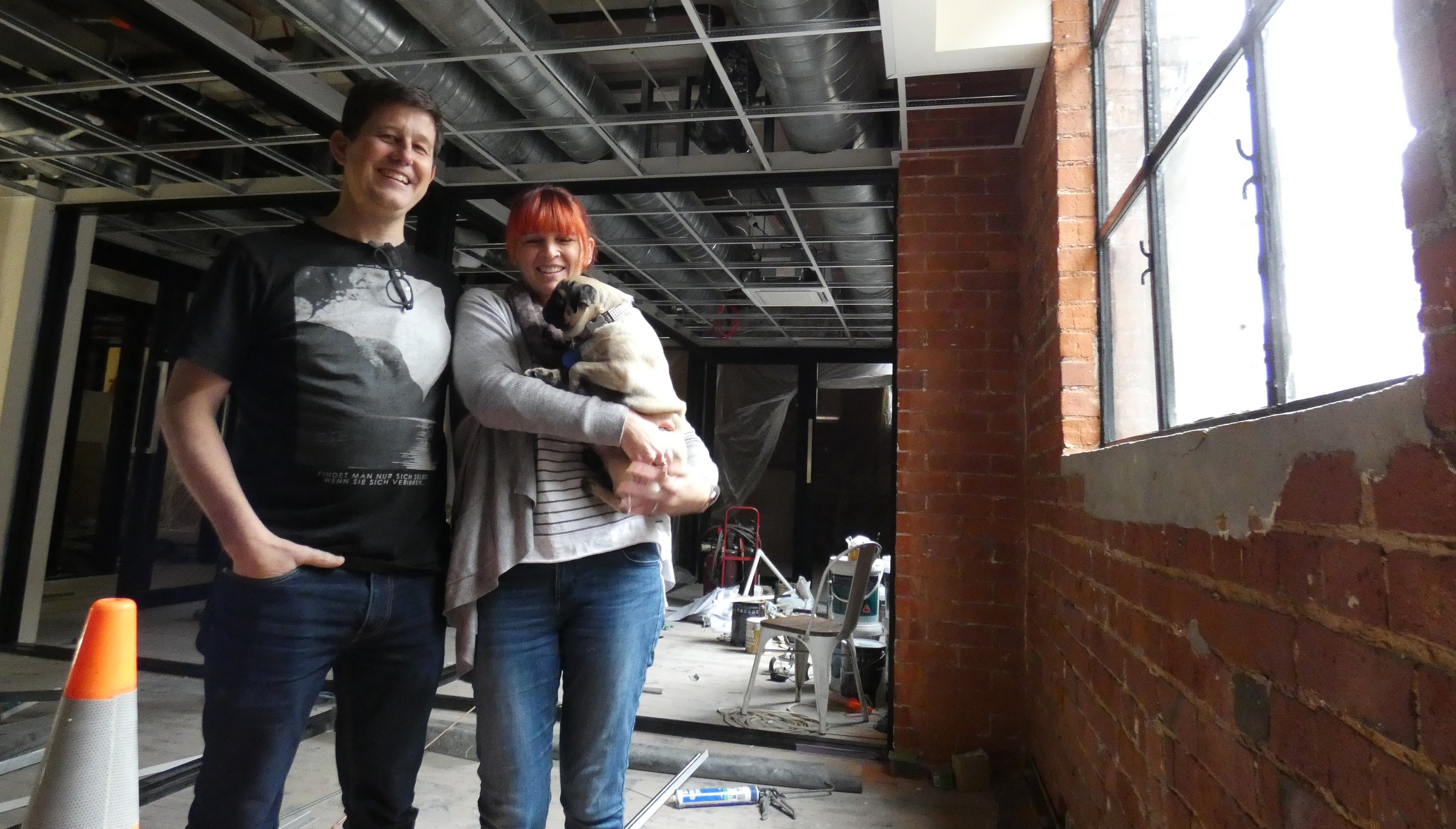 Petridish co-founders Jason and Kate Lindsey, with their pug Chai, inspect the next space being...