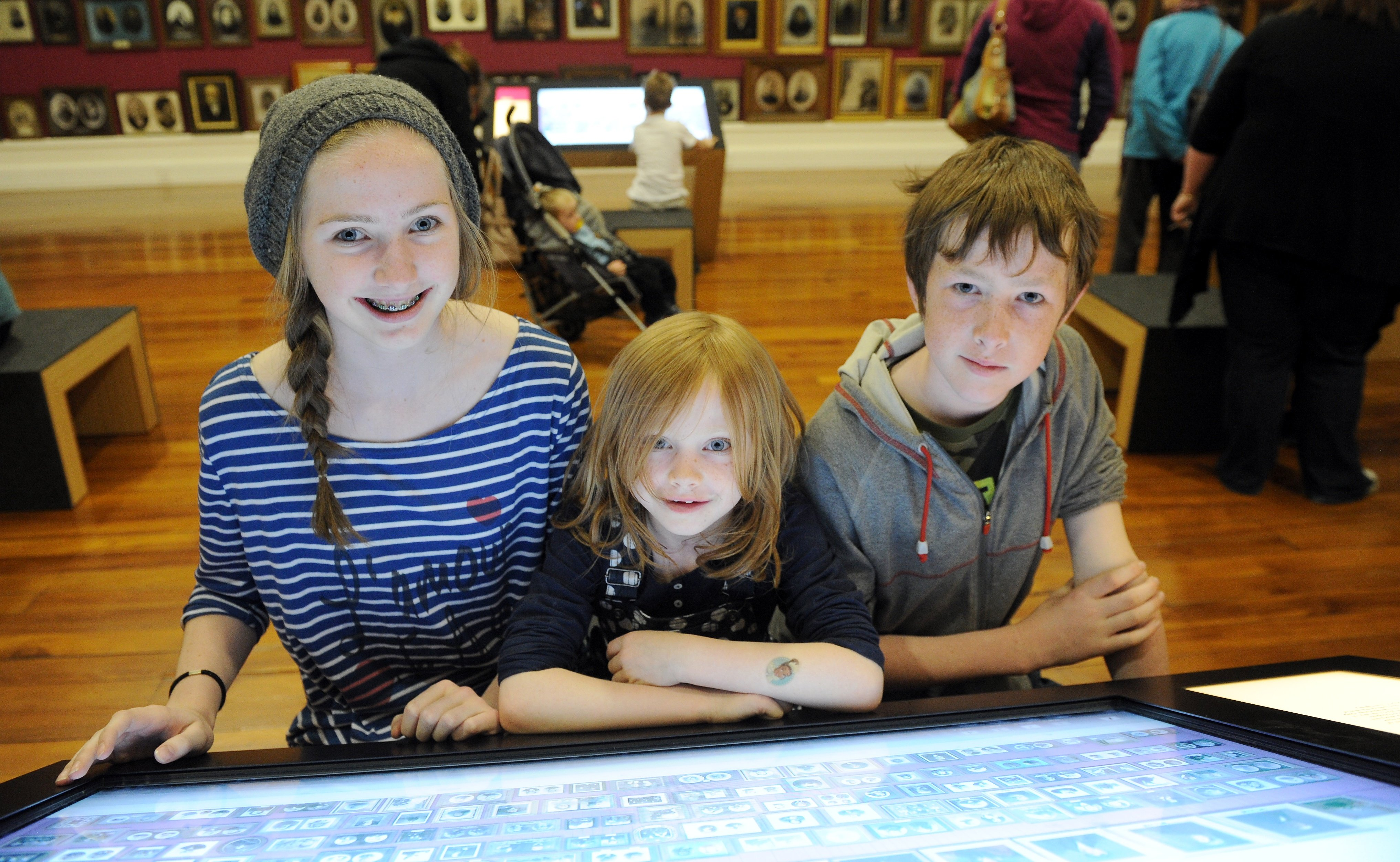 Children are entertained by a display at the reopening of Toitu Otago Settlers  Museum in 2012.