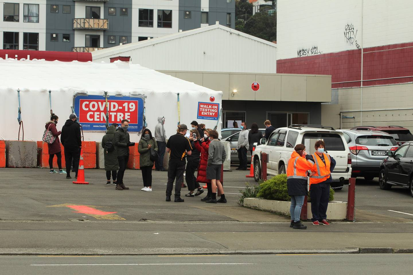 People wait outside a Covid-19 testing site at Taranaki St in Wellington today. Photo: NZ Herald