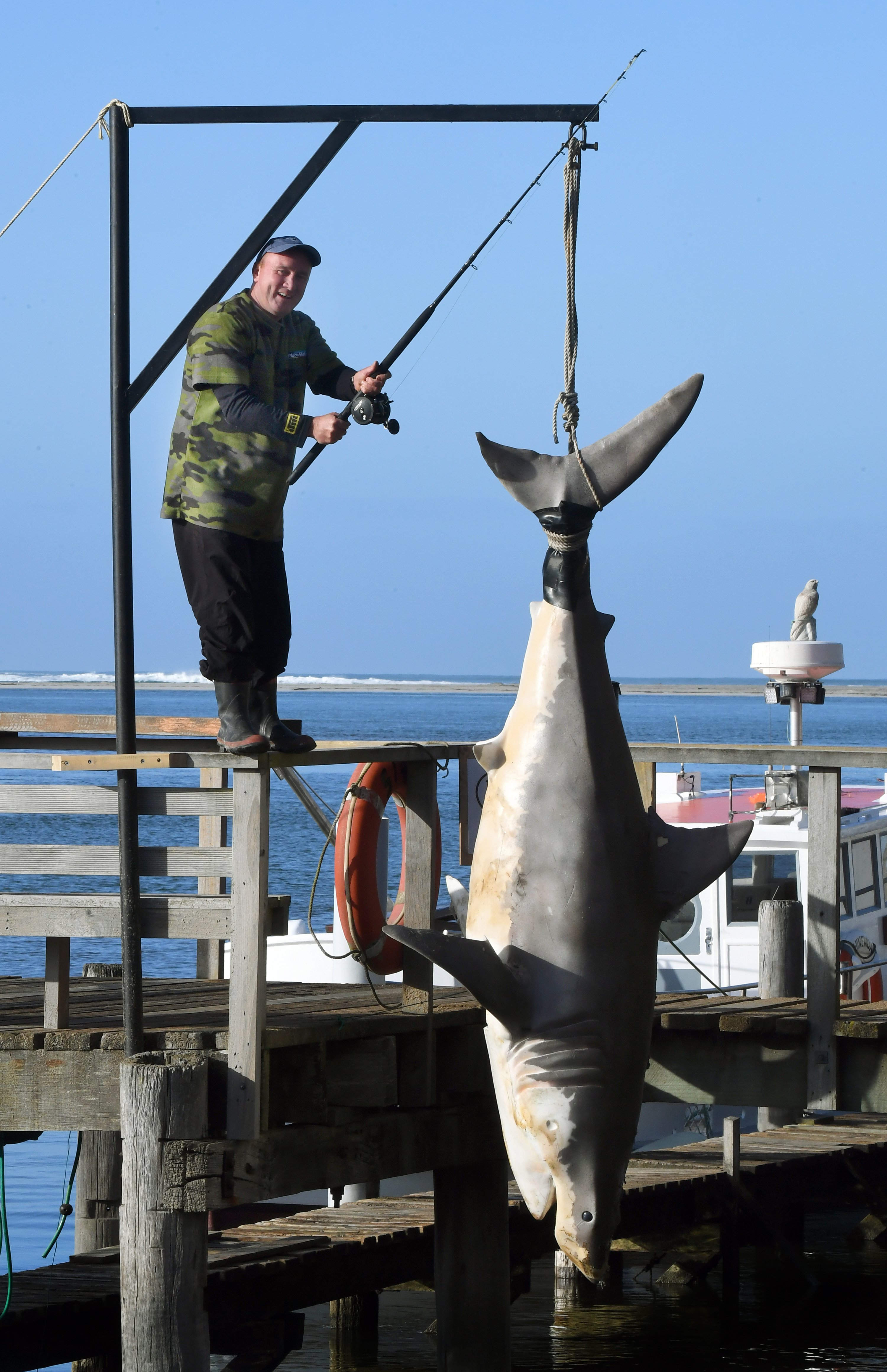 Glen Patterson shows off his great white shark prop, which has attracted plenty of attention at...