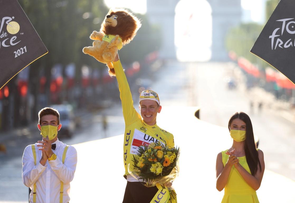 Tadej Pogacar celebrates his victory on the podium in Paris. Photo: Reuters