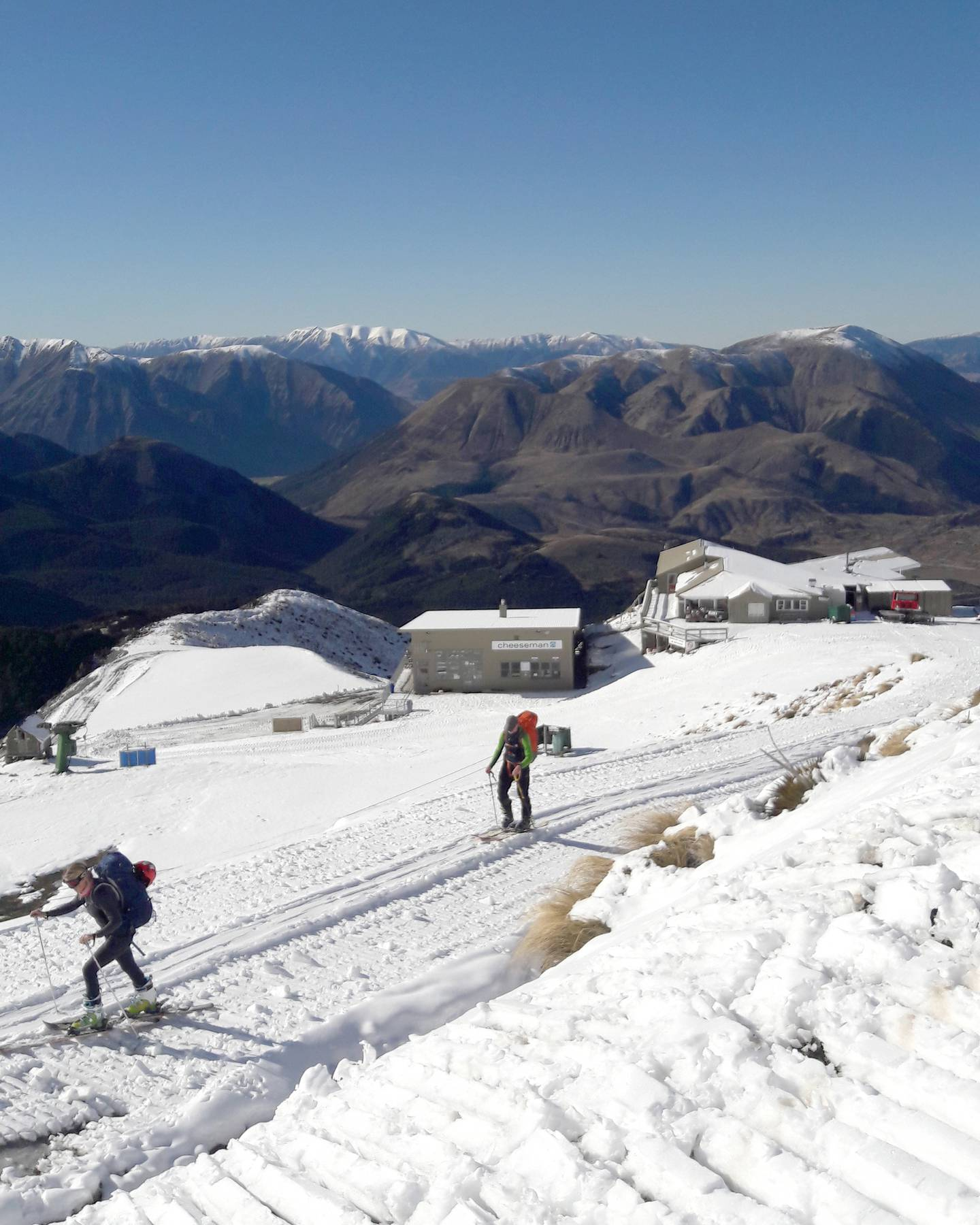 Tour skiers walk up to the snowline in the Cheeseman Ski Area. Photo: Thomas Bywater