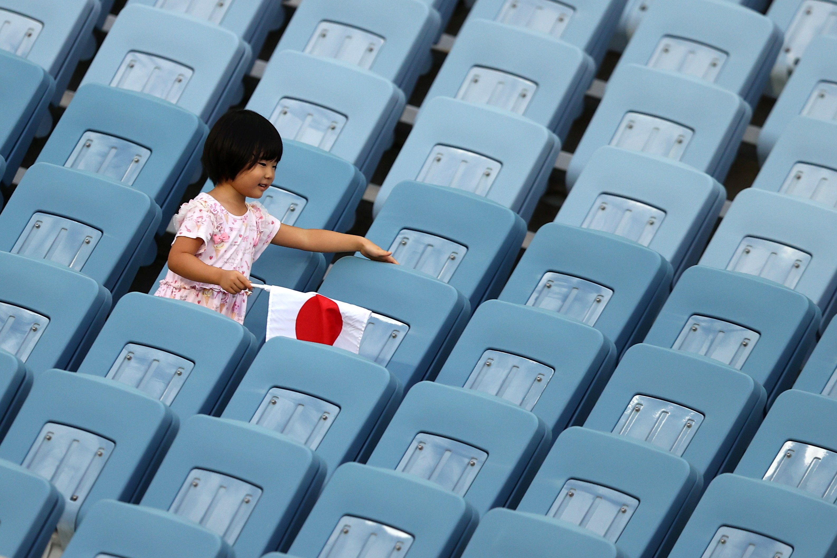 A young girl watches the women's football pool match between the Football Ferns and Sweden this...