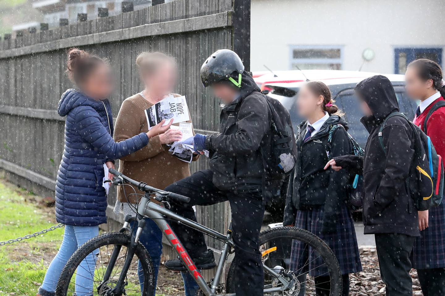 The protestors attempted to pass on misinformation pamphlets, stating that side effects of the...